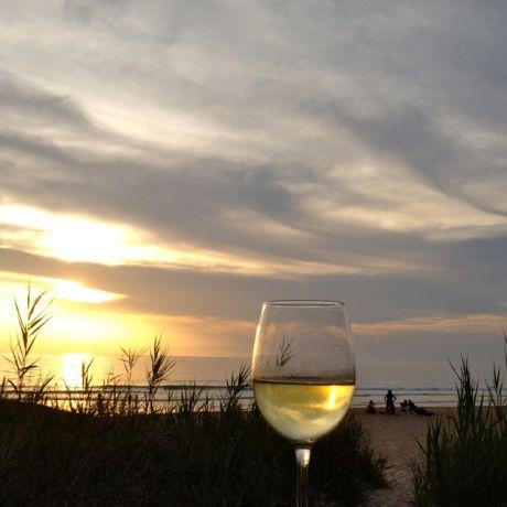 Zonsondergang met een wijntje