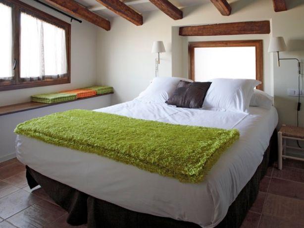 slaapkamer in een van de appartementen