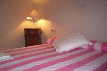 slaapkamer in een van de appartementen voor 4 personen (C)