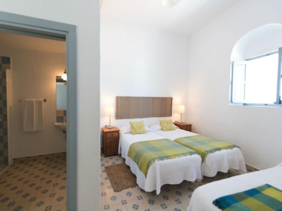 Één van de kamers met extra bed